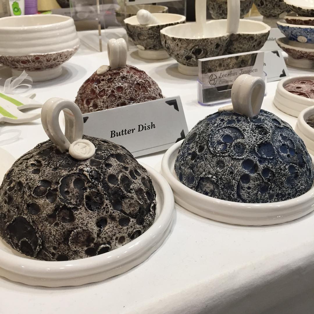 Luna-ware butter dishes in 3 colors: silver moon, blue moon & blood moon.  Find them at booth S-33